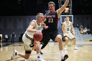 Ben Boots drives against a Benedictine player to open the season on Nov. 15. In the game, Boots had 22 points on 12 shots.For the game, Kasper tied a career high with four touchdowns.