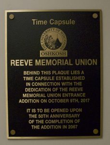 The Time Capsule sits behind this plaque in the new addition of Reeve Memorial Union. Included in the time capsule are 2017 mementos such as fidget spinners and PopSockets. In addition, there is a letter from current Chancellor Andrew Leavitt to the future chancellor of UWO. Campus Life Executive Director Jean Kwaterski said she hopes students return in 2067 to see it opened.