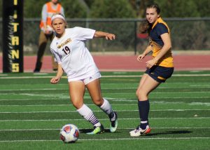 UW Oshkosh senior defender Felicia Retrum addresses the ball on Saturday. In her career, Retrum has nine total points.