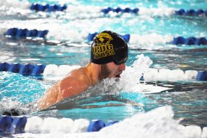 A UWO male swimmer takes part in the breaststroke during the Gene Davis Invitational at Lawrence University Nov. 18.
