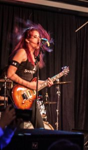 """Eminence guitarist Molly Marie rocks the band's set at Titan Underground. The band is based out of Appleton, but most of the members attending UWO. """