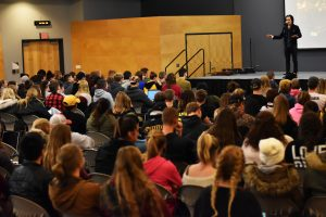 David Zach discusses human trafficking with UW Oshkosh students in Reeve Memorial Union Ballroom Tuesday. Zach described himself as an abolitionist and has written songs about freedom for his band.