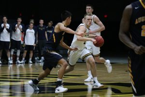 Ben Boots drives past the defense to the basket against Augustana. In the game Saturday, Boots had 23 points on 15 shots.