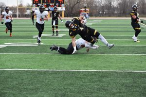 No. 4 senior running back Dylan Hecker gains yardage against Wartburg College at home.