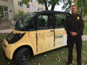 The UWOPD Saferide vehicle sits outside of Radford Hall with Police Sergeant Chance Duenkel.