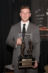 Brett Kasper poses at the Gagliardi award ceremony where he received the 2017 Gagliardi Trophy. This award is given out to the player who excels in academics, athletics and community service in the Division III level. Kasper was announced the winner of this award after beating out three other finalists, one of which was from UW-La Crosse. He is the first player in UW Oshkosh football history to win this award.