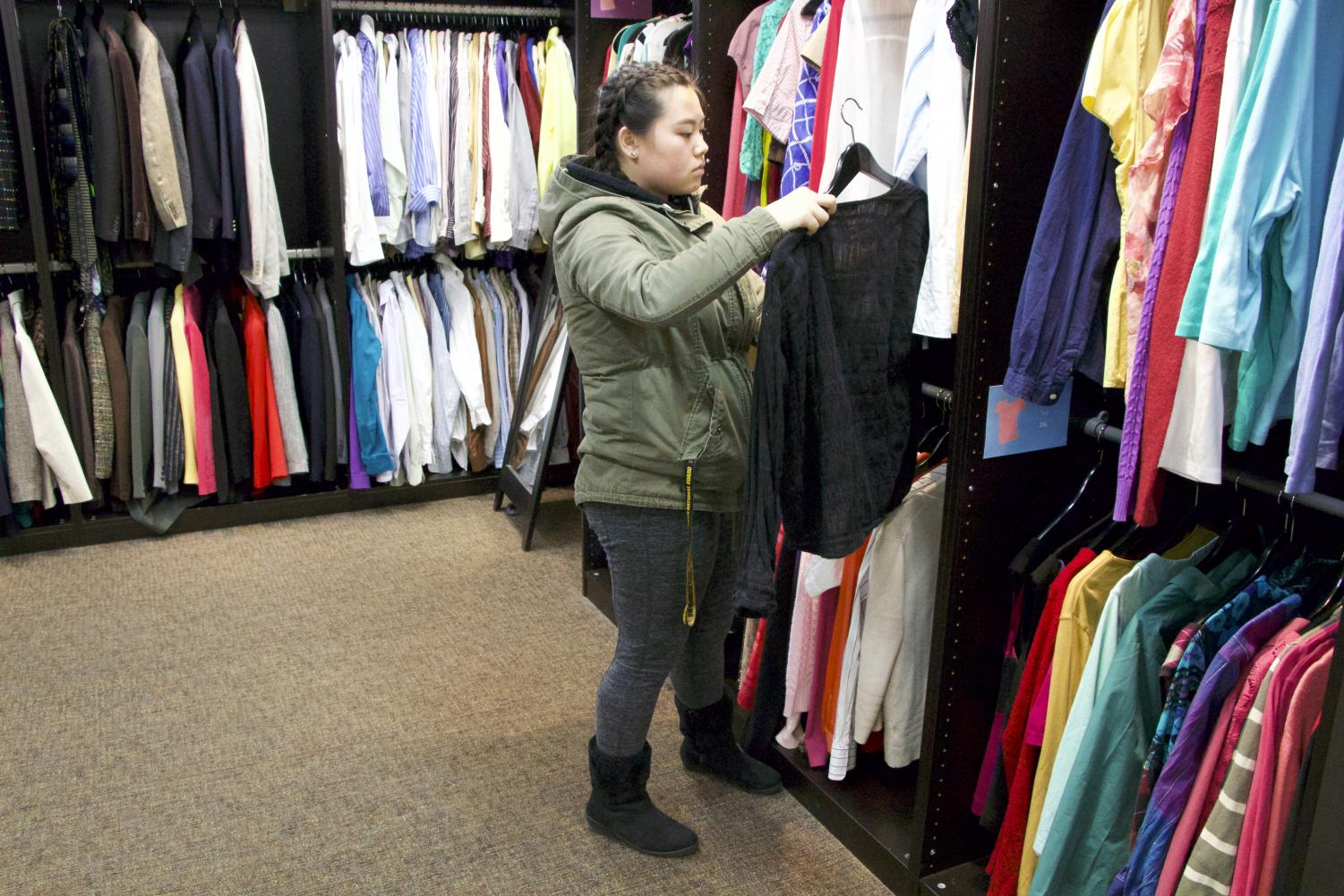 Students picks out free clothing items available at Career Services.