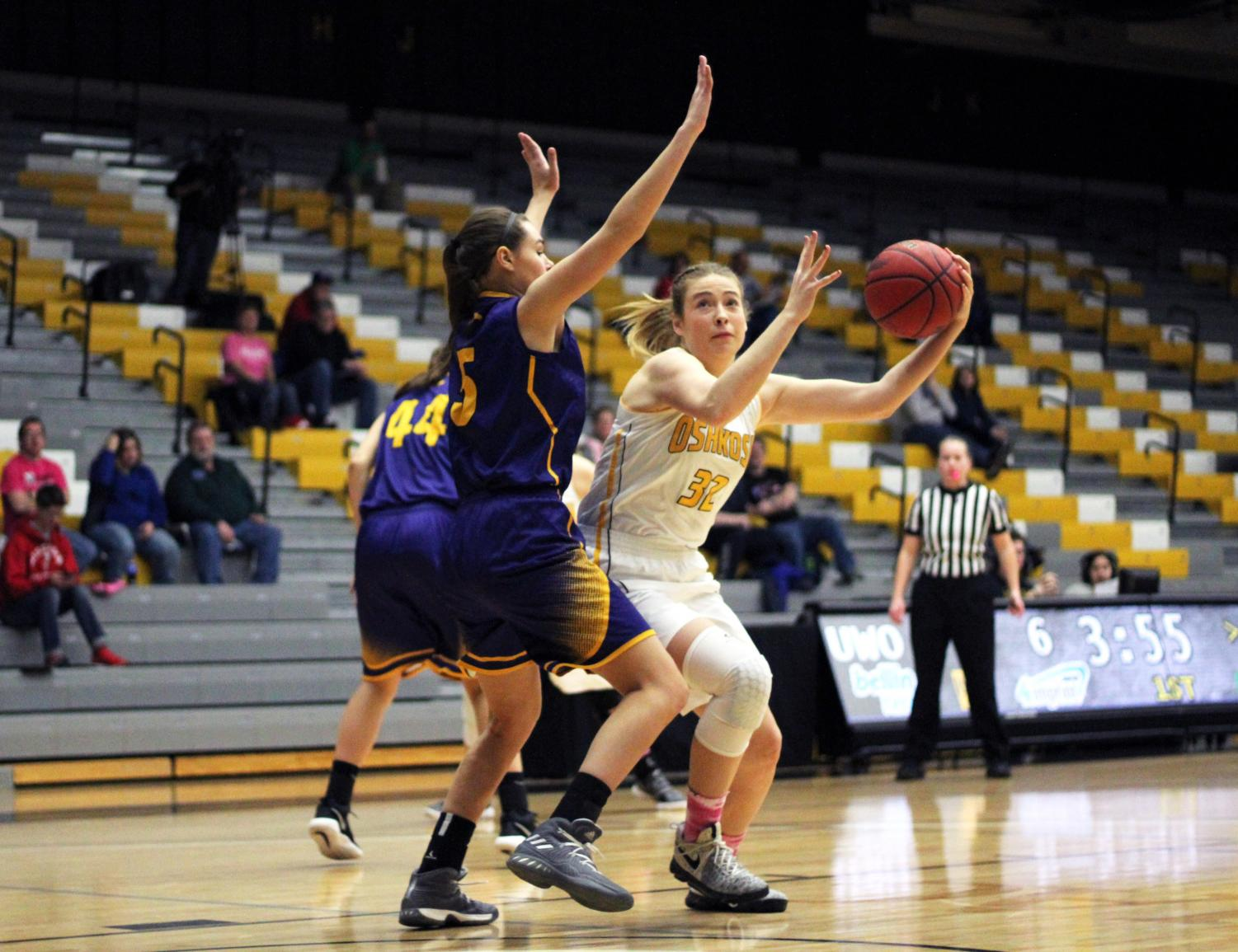 Senior forward Madeline Staples receives the ball in the post and works to make a move towards the basket against UW-Stevens Point on Wednesday. Staples averages five points per game on 42.4 percent shooting this season.