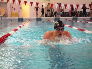 A male Oshkosh swimmer competes at Ripon in the breaststroke event, where Oshkosh took home second place as Grady Hilgendorf finished with a time of 1:06.01.