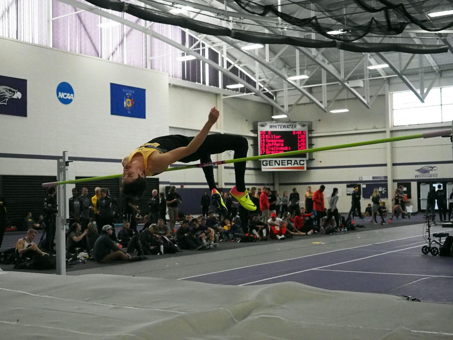 UWO junior Jake Skoien jumps over the current height to beat at Saturday's meet in Whitewater. Skoien, who is a sprinter for the Titans, jumped to a height of 1.95 meters on the day, which was the ninth-highest seed but did not jump in the finals.