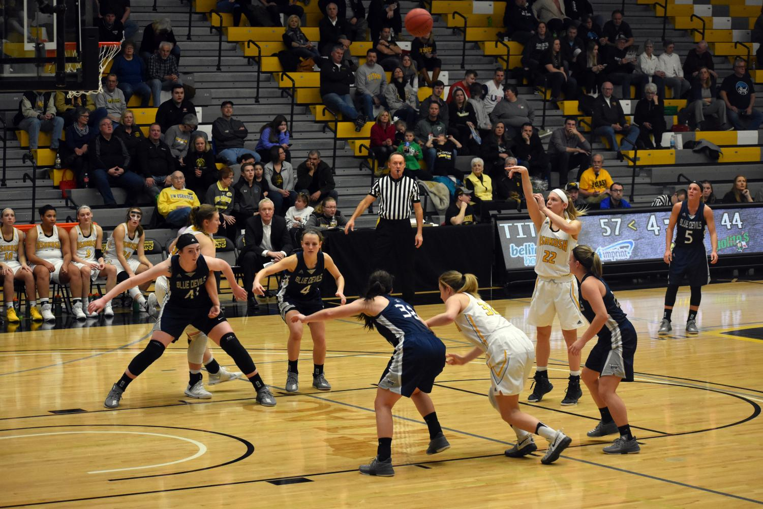 UW Oshkosh junior forward Melanie Schneider releases a free throw as freshman Karsyn Rueth (left) and senior Madeline Staples (No. 32) move off the block to gain position for a potential rebound. In the regular season finale against UW-Stout, Schneider had five points.