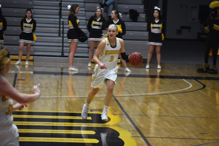 Senior guard Jaimee Pitt moves the ball up the court and looks to pass.