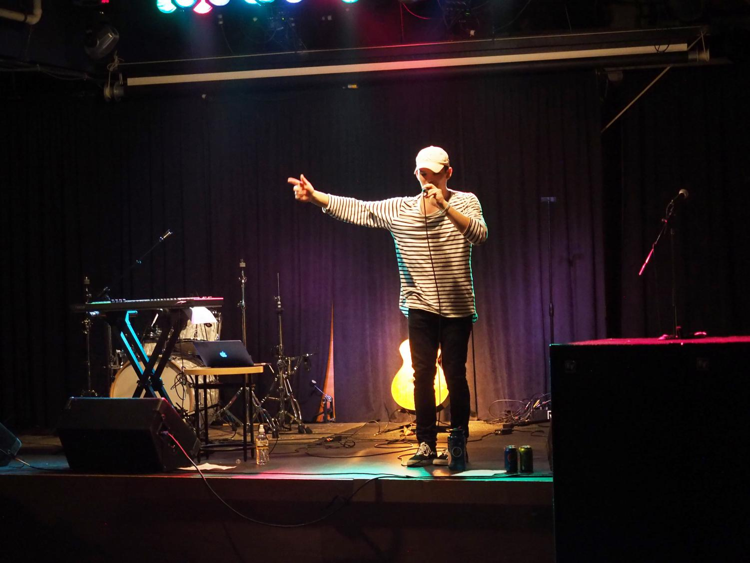 Solo artist Zachary Mayer sings during his set at Pop Night. Mayer played multiple instruments during his performance, where he sang original songs as well as a few covers of popular songs.
