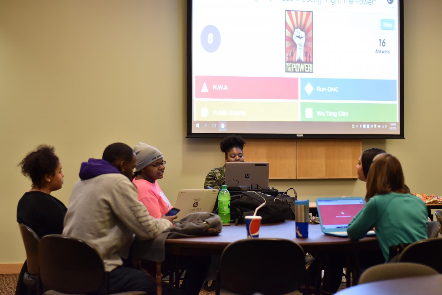 Students participate in trivia games during Black Student Union's Black History Month trivia night.