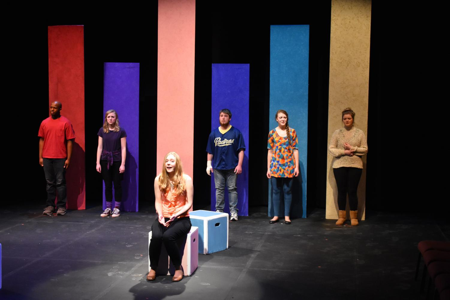 "All six of the characters featured in ""Find Me"" line up in their starting places. The play focuses on stories told by all of the characters without talking to one another."