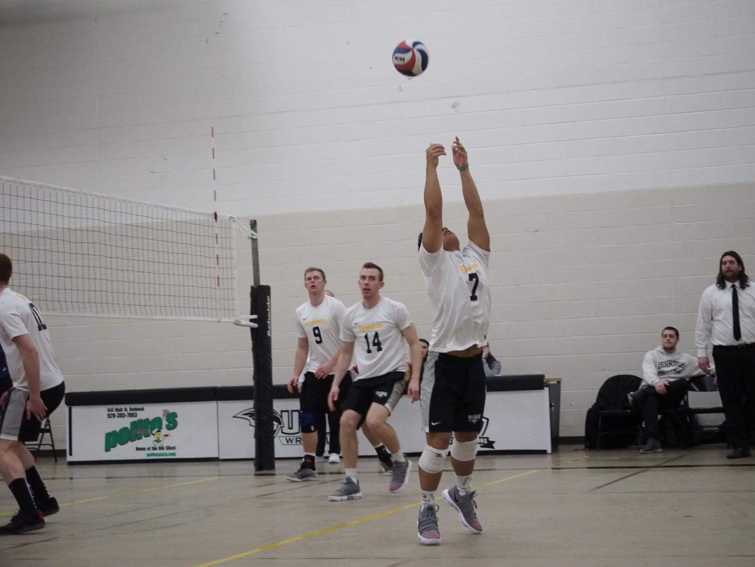 Senior libero/defensive specialist Samuel Moua returns the ball with a reverse bump against the UW-Whitewater Warhawks on March 8.