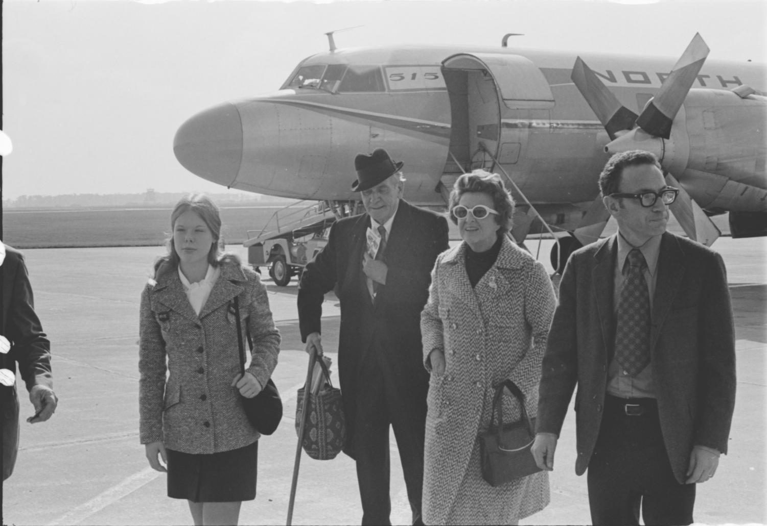 March (left) arrives at the Wittman Regional Airport in Oshkosh with his wife (right) and others.