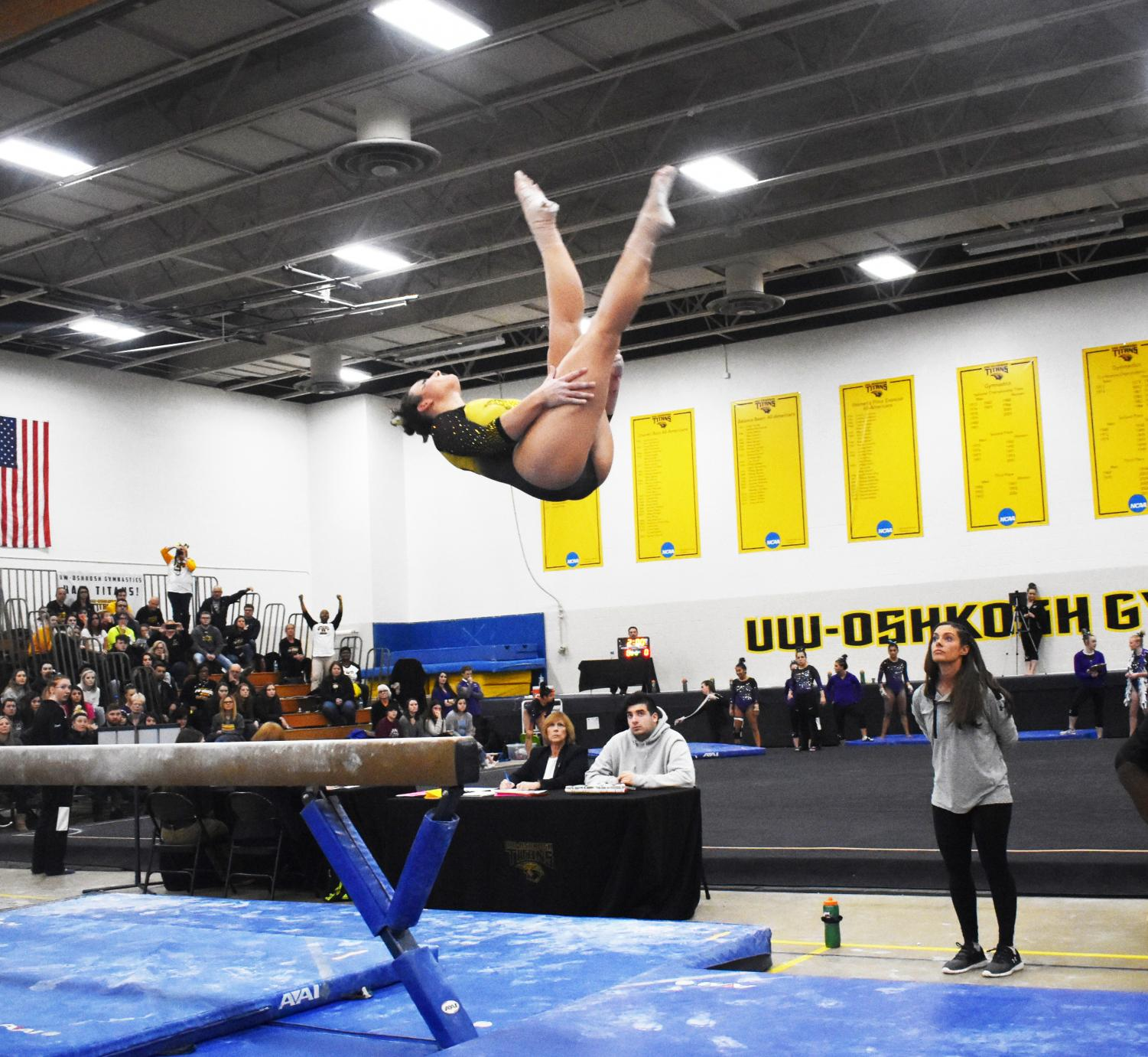A UWO gymnast dismounts from the balance beam against UW-Whitewater last week as Titan head coach Lauren Karnitz looks on. Their next meet is at the WIAC Championship/NCGA West Regional in St. Peter, Minnesota on Sunday at 2 p.m.