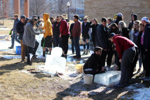 UWO students gather around ice sculptures to discuss their favorite and least favorite designs.