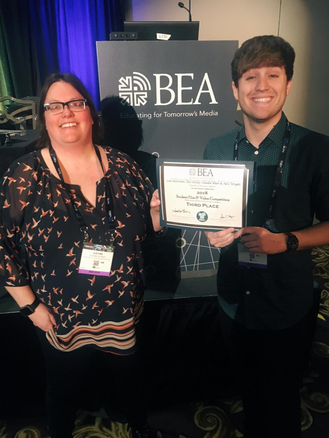 """Justine Stokes and Cole Boettcher show the third place award for """"Cole and Claudia's Christmas Show"""" at Brodcast Education Association's  festival in Las Vegas on Monday."""