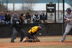 UWO junior catcher Jensen Hinton blocks a pitch in the dirt against UWSP on April 12. On the season, Hinton has a .276 batting average with two home runs and 14 RBIs.