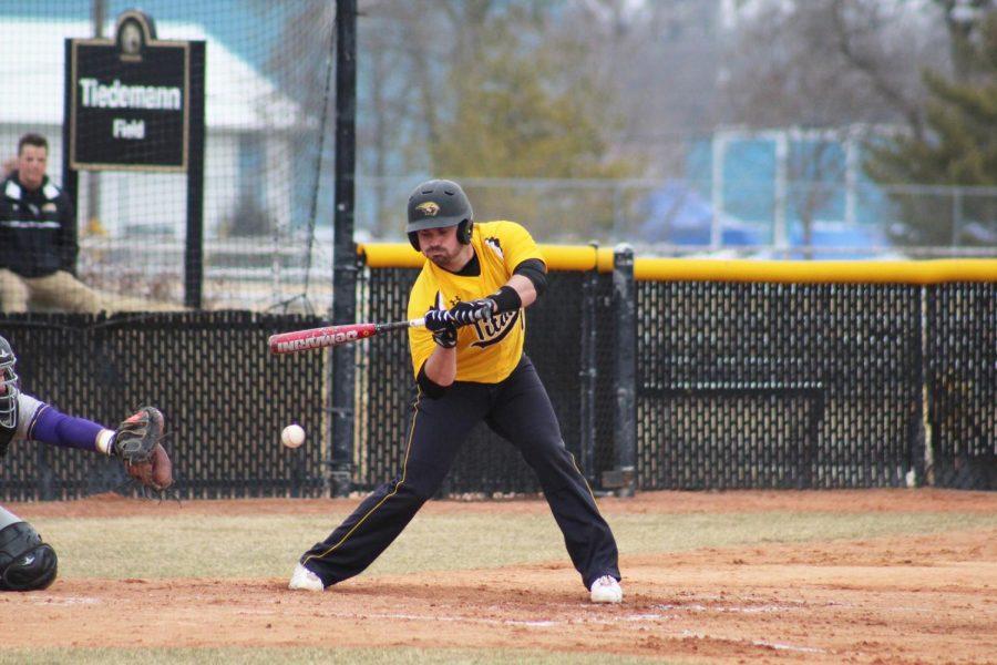 Left fielder Logan Reckert checks his swing Thursday.