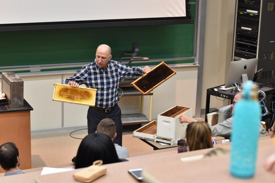 Executive Director for the Nicaragua Bee Project Michael Bauer shows audience beekeeping supplies.