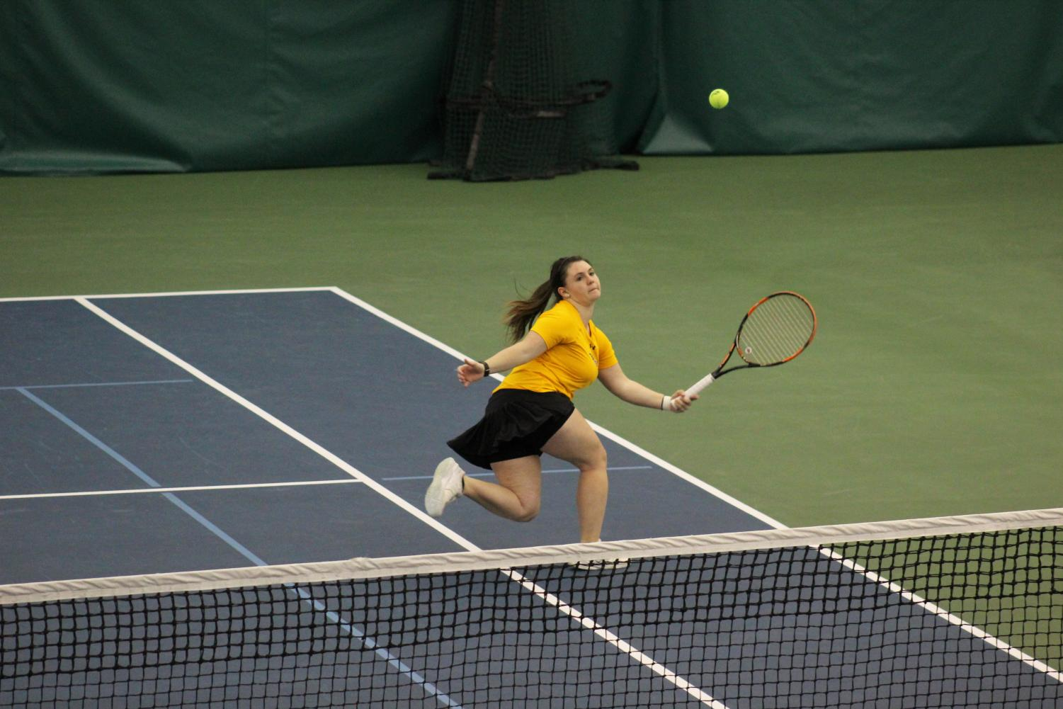 Sophomore Samantha Koppa lunges to return a ball during Sunday's match against Carthage College in Neenah. So far on the season, Koppa has a record of 11 wins and 8 losses in singles play, while she has earned 8 wins in doubles matches.