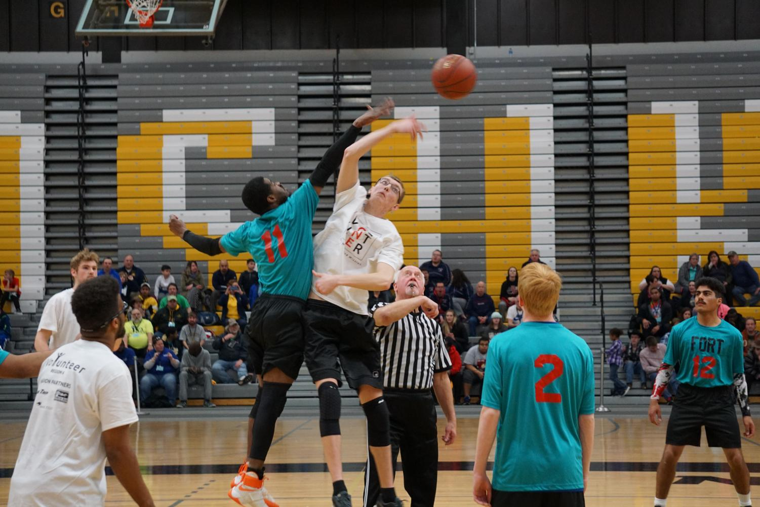 Team Wisconsin athlete Jake Caston goes up for the opening tipoff during Saturday's game.