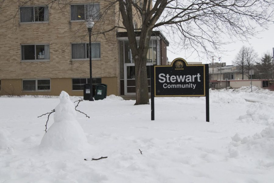 One of the many snow men around campus sits in front of Stewart.