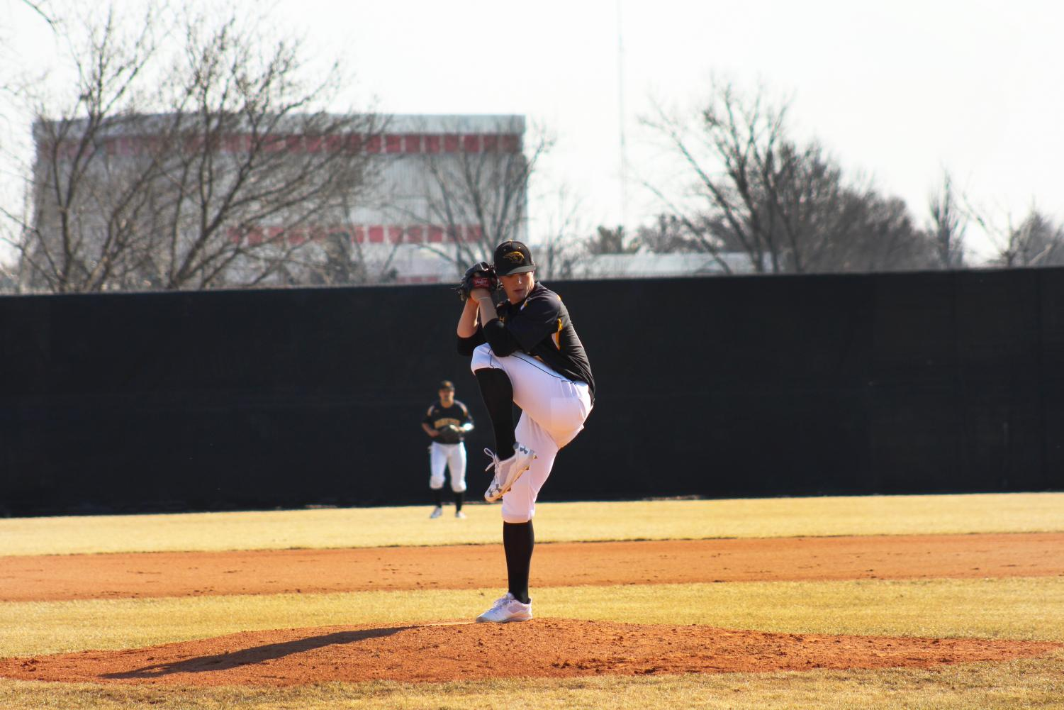 Junior hurler Colan Treml delivers a pitch against Wisconsin Lutheran College. Treml is 5-1 in 6 appearances this season.