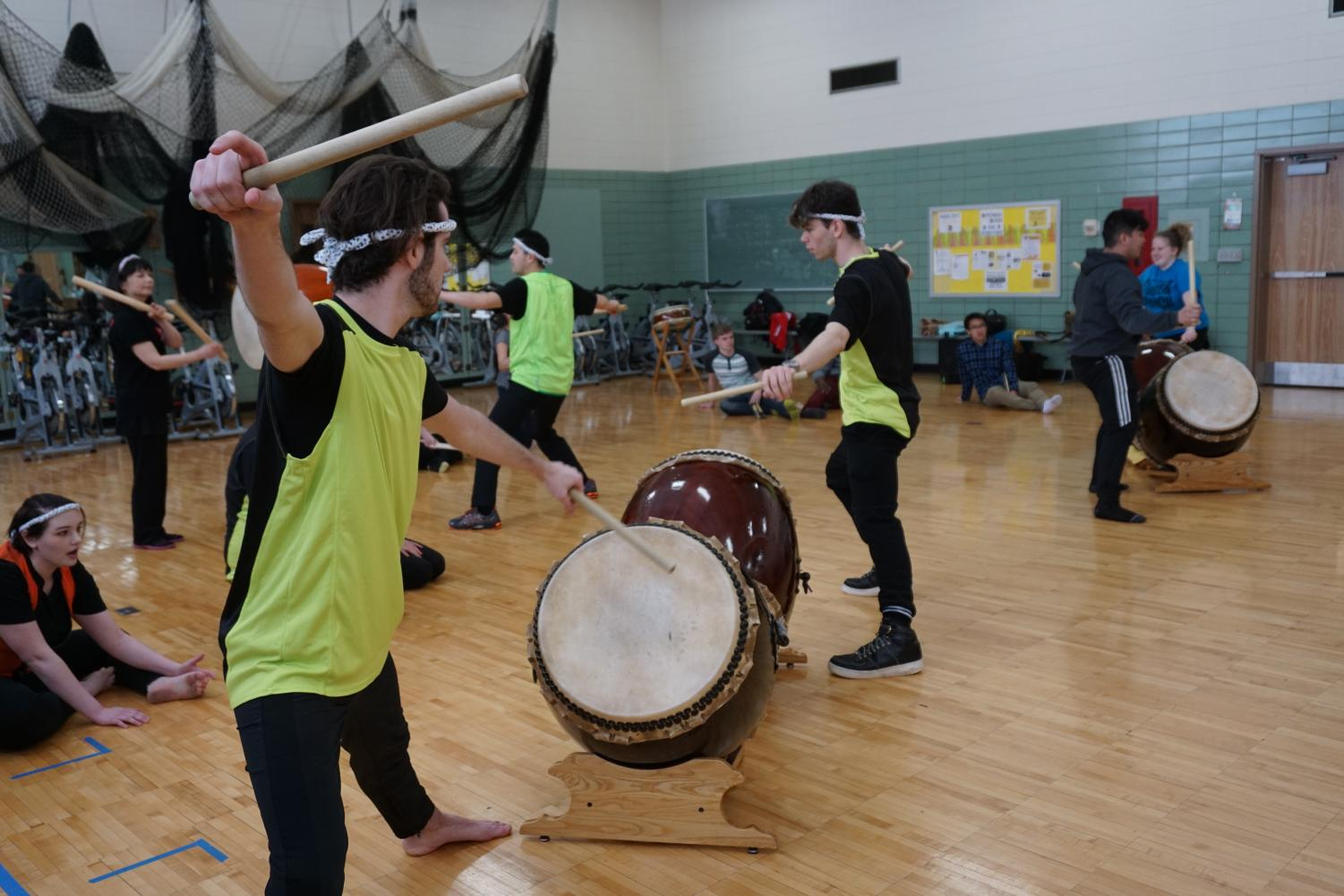 The UW Oshkosh Taiko members show off their skills.