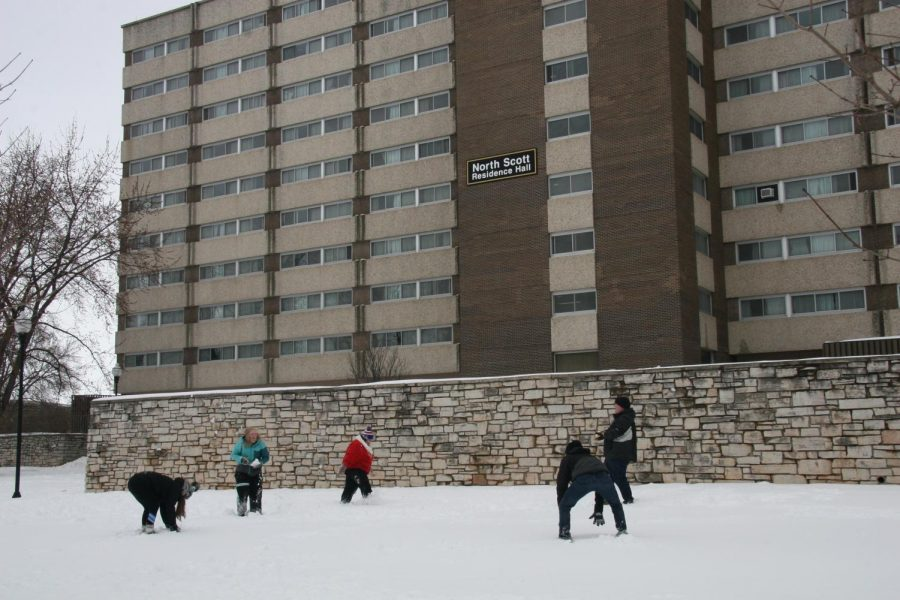Students have a snowball fight in the fresh April snow in front of North Scott Residence Hall after the blizzard.