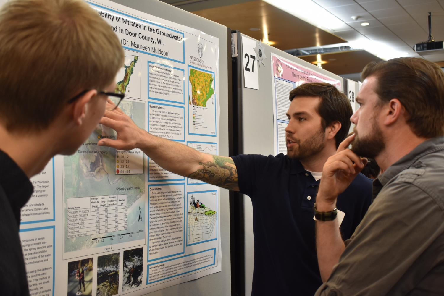 UWO Student explains his project to visitors at the Celebration of Scholarship and Creativity event.