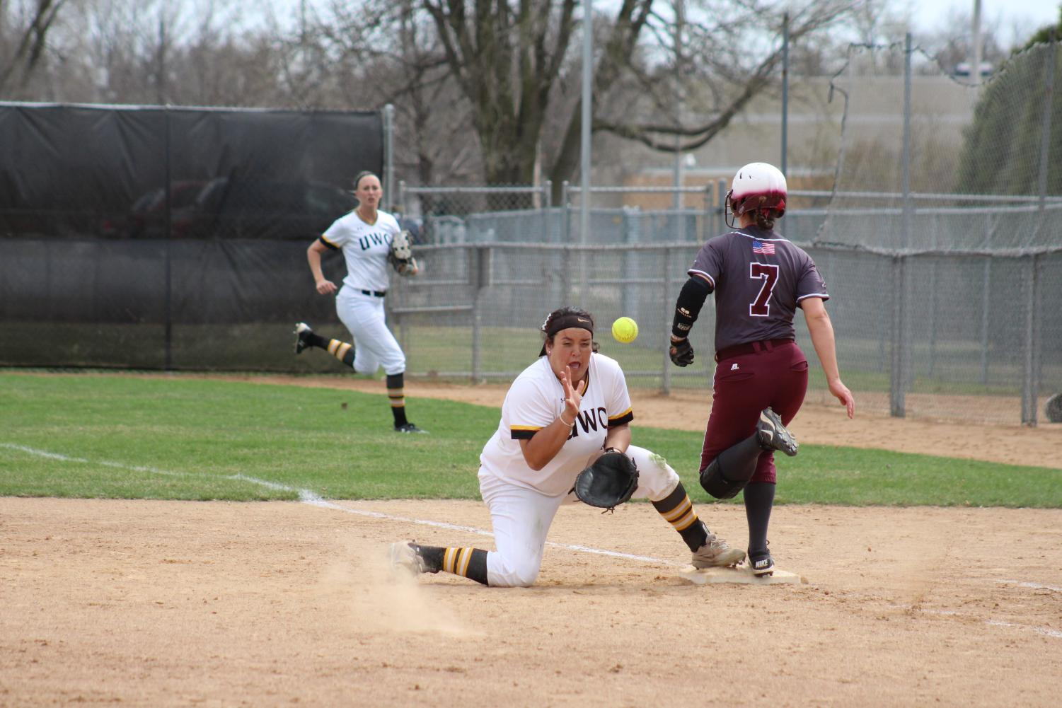 Oshkosh junior first baseman Kaitlyn Krol attempts to field a throw in Tuesday's sweep against UW-La Crosse. In 33 games this season, Krol has 32 hits, including six doubles, one triple and two home runs, and only two strikeouts.