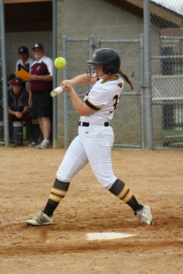 Sophomore outfielder Claire Petrus swings at a high pitch against the Eagles. On the day, Petrus had two runs knocked in.