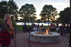Musician Haley Klinkhammer attracts many students to come listen to her performance during Campfire on the Fox on Thursday.