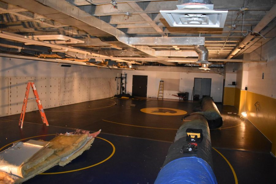UW+Oshkosh+practice+wrestling+facility+currently+being+renovated+by+Titan+wrestling+team.