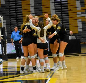 UWO volleyball members celebrate earning a point during the Pizza Hut Classic.