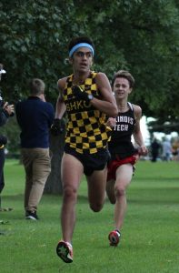 Sophomore Fabian Salinas Arroyo looks for rival runners during the final stretch of the race.