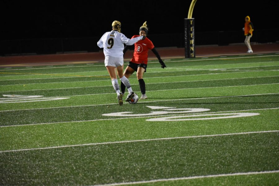 Senior Alexis Brewer dribbles around a UW-River Falls defender on Saturday night. The Titans came away with a 2-0 victory, improving to 3-3 in the WIAC.