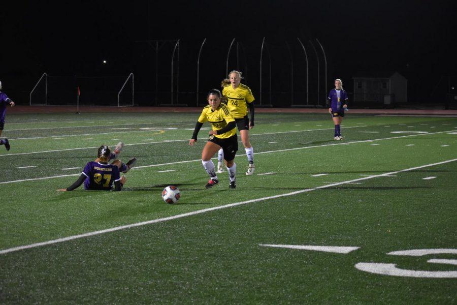 Titan forward Ashley Baalke moves ball versus past defender in Wednesday's match.