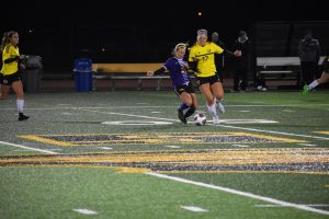 Tory Schumann fights for the ball near midfield.