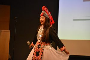 Selena Yang sings a traditional Hmong song in a traditional dress.