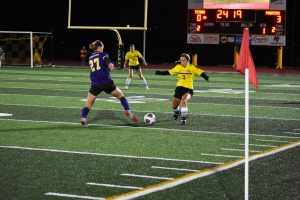 UWO defender Taylor Simkowski meets Pointer defender at the ball while UWO midfielder Maddie Morris watches from a far.