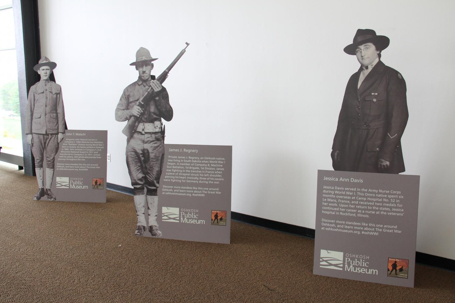 Cutouts of Oshkosh residents during World War I are displayed on the third floor of Reeve Memorial Union.