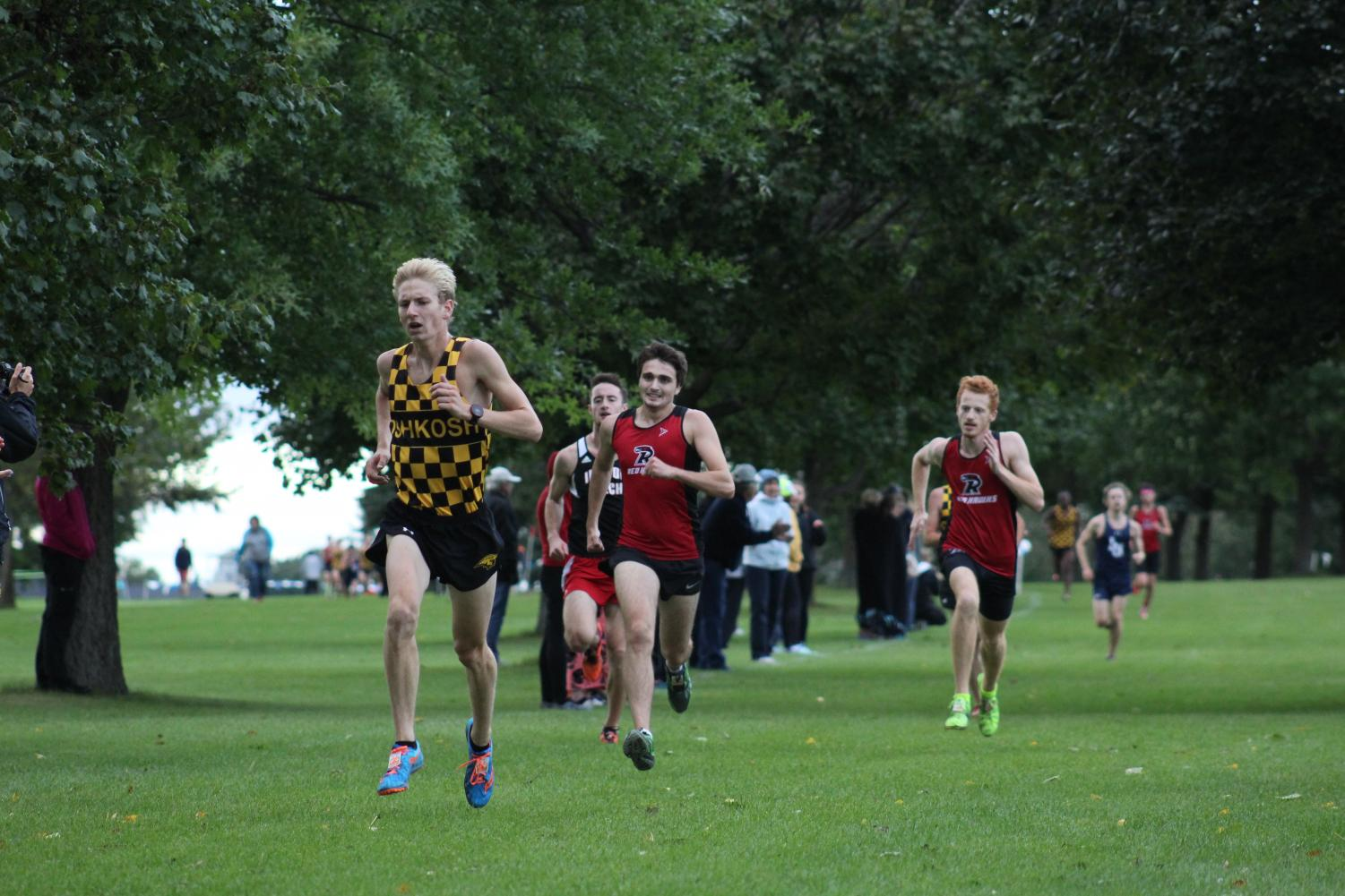 UWO freshman Andrew Strasser fends off an opposing runner as he sprints toward the finish line at the Titan Fall Classic on Sept. 21.