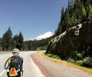 Bike & Build member, Megan Althus travels through the mountains, celebrating Earth Day.