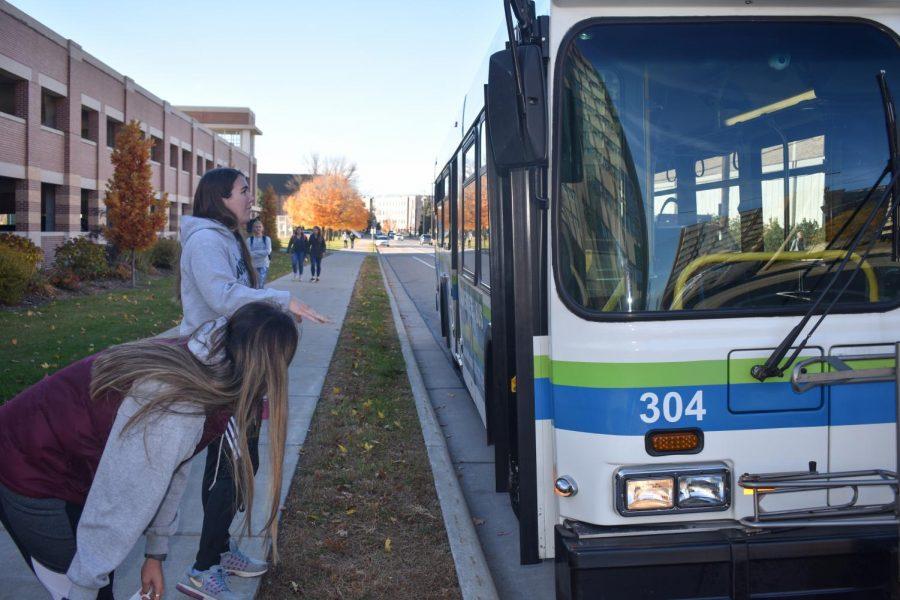 UWO students Jordyn Martinez and Jennifer Kamrath prepare to depart on the GO Transit bus route.