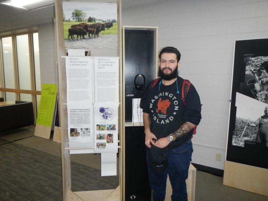 UWO student and Oneida Nation member Nick Metoxen shows off his display.